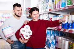 Young couple choose toilet paper in the shop Royalty Free Stock Photos