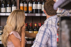Young couple chooses the wine Stock Image