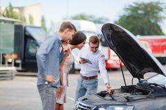 Car salesman at the dealership showing the engine to a client royalty free stock images