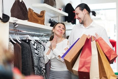 Young couple choosing clothes at boutique Stock Photo