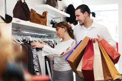 Young couple choosing clothes at store Royalty Free Stock Photos
