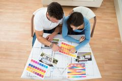 Young couple choosing color from swatch Royalty Free Stock Photos