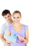 Young couple choosing colors for painting a room Royalty Free Stock Image