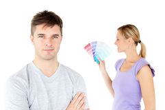 Young couple choosing colors for painting a room Stock Image