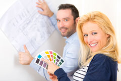 Young couple choosing colors of their future house Royalty Free Stock Image