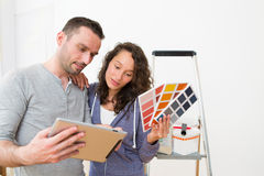 Young couple choosing colors of their new flat Royalty Free Stock Photography