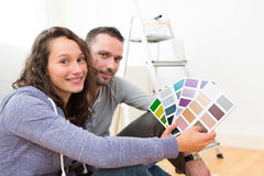 Young couple choosing colors of their new flat Royalty Free Stock Images