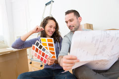 Young couple choosing colors of their new flat Royalty Free Stock Image