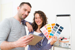 Young couple choosing colors of their new flat Stock Photo