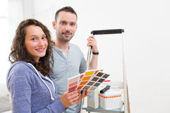 Young couple choosing colors of their new flat Royalty Free Stock Photos