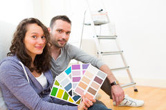 Young couple choosing colors of their new flat Stock Images