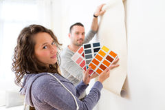 Young couple choosing colors of their wallpaper Stock Image