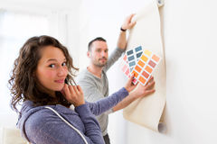 Young couple choosing colors of their wallpaper Stock Photo