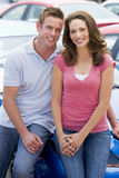 Young couple choosing new car. On lot Royalty Free Stock Photos