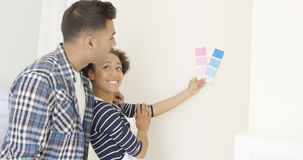 Young couple choosing a paint color Stock Photography