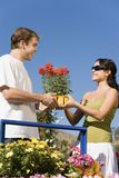 Young couple choosing potted flowers Royalty Free Stock Photo