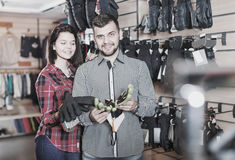 Young couple choosing protective gloves Stock Photos