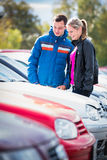 Young couple choosing the right car Stock Photo