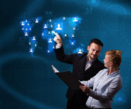 Young couple choosing from social network map Stock Photo
