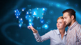 Young couple choosing from social network map Stock Photos