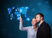 Young couple choosing from social network map Stock Image