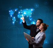 Young couple choosing from social network map Stock Photography
