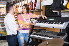 Young couple choosing synthesizer in music shop Stock Images