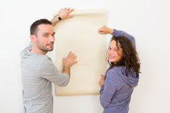 Young couple choosing their wallpaper Royalty Free Stock Image
