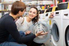 Young couple choosing washing machine Royalty Free Stock Photos