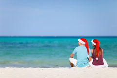 Young couple on Christmas beach vacation Stock Photos