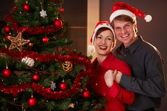 Young couple at christmas eve Stock Images