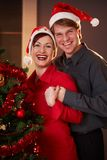 Young couple at christmas eve Royalty Free Stock Photo
