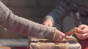 Young couple on christmas eve wrapping gifts. stock video footage