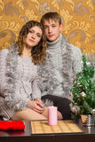 Young couple in Christmas party. Two young sweethearts cute spend time Royalty Free Stock Photography