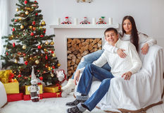 Young couple at the Christmas tree. Stock Photo