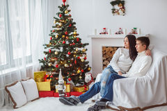 Young couple at the Christmas tree. Stock Images