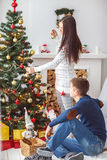 Young couple at the Christmas tree. Royalty Free Stock Image