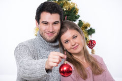 Young couple and Christmas tree Stock Images