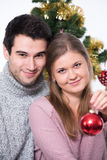 Young couple and Christmas tree Royalty Free Stock Photo