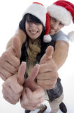 Young couple with chritsmas hat. On an isolated white backgound Stock Image