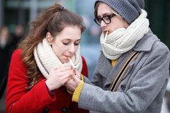 Young couple with cigarettes Stock Photography