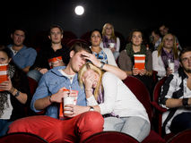 Young couple at cinema Stock Image