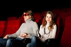 Young couple in the cinema Royalty Free Stock Image