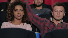 Young couple at the cinema stock footage