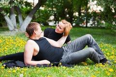 Young couple in a city park Stock Photos