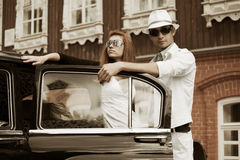Young couple and classic car Stock Image