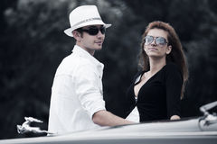 Young couple with a classic car Stock Photography