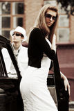 Young couple with classic car Royalty Free Stock Photography