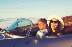 Young Couple in Classic Vintage Sports Car Royalty Free Stock Photos