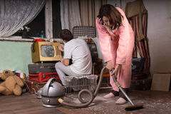 Young Couple Cleaning an Abandoned Room Stock Image
